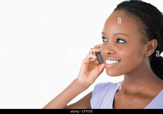 Close up of woman talking on her phone on white background - Stock Image