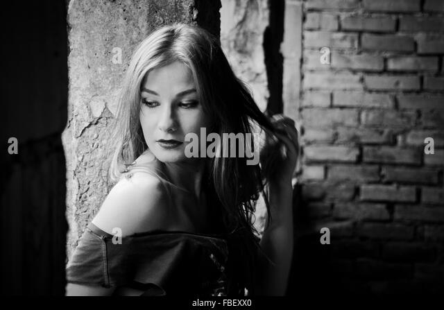 Young Fashion Model In Incomplete Building Window - Stock Image