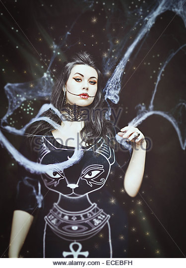 Witch halloween studio portrait - Stock Image