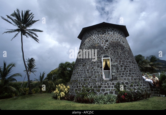West Indies St. Kitts Rawlins Plantation 1690 sugar plantation windmill now honeymoon suite couple - Stock Image