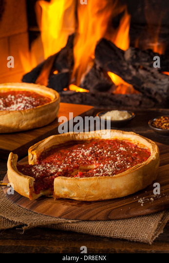 Chicago Style Deep Dish Cheese Pizza with Tomato Sauce - Stock Image