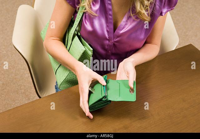 Woman holding purse - Stock Image