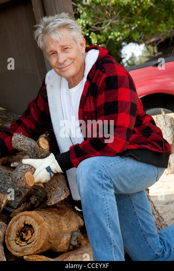 Portrait of senior man working at lumber industry - Stock Image
