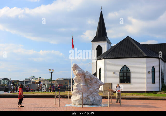 Norwegian Sailors Church with Statue of Captain Scott Cardiff Bay Cardiff Wales - Stock Image