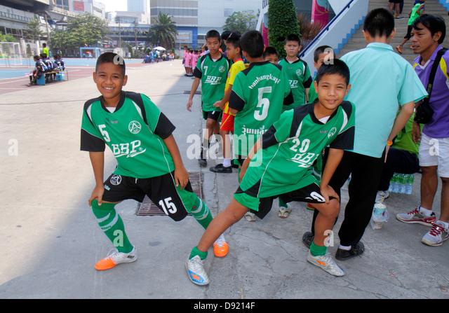 Thailand Bangkok Pathum Wan Rama 1 Road National Stadium soccer football Asian boy student team teammates uniform - Stock Image