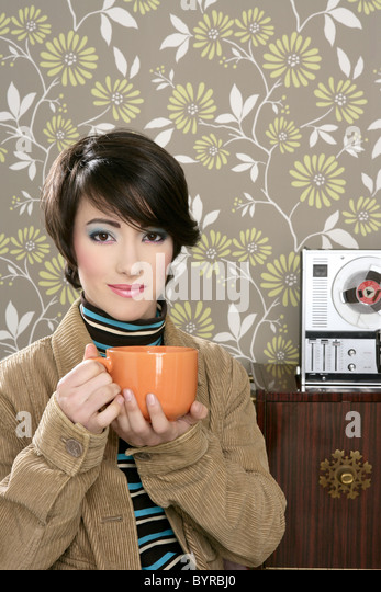 coffee cup drinking retro fashion 60s woman vintage wallpaper - Stock Image