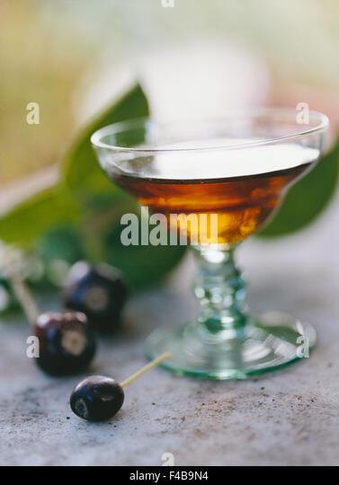 alcohol catalogue 2 close-up cognac color image detail drink food and drink glass liqueur olive Swedish catalogue - Stock-Bilder