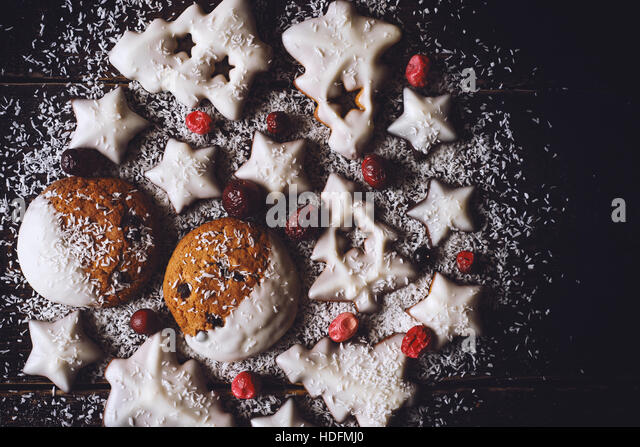 Christmas ball made by  cookies and berries on the wooden background - Stock Image