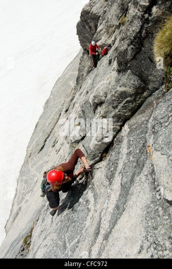 Two climbers tackle the impressive south face of Asgard Peak in the Valhalla Mountains, Selkirk Range, British Columbia, - Stock Image