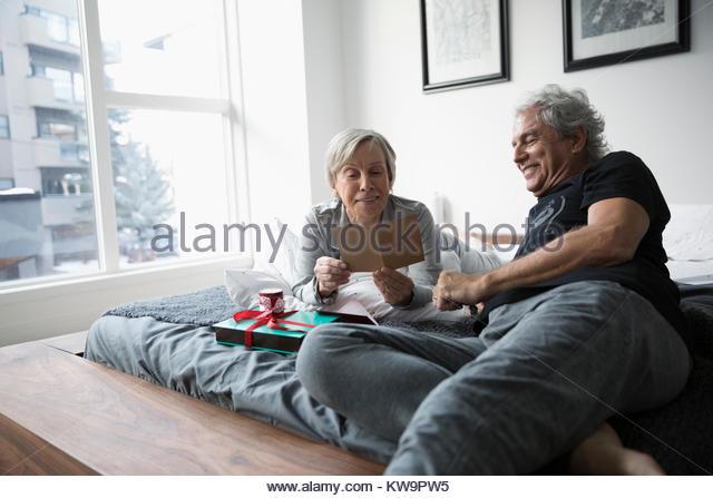 Happy senior couple opening Valentine - Stock Image