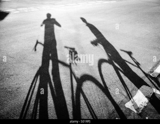 Cyclist shadow - Stock Image