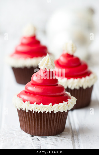 Santa hat cupcakes - Stock Image