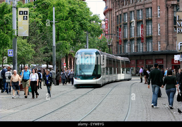 Modern tram in the pedestrianised Rue des Francs-Bourgeois in the centre of Strasbourg, France. Left: the Place - Stock Image