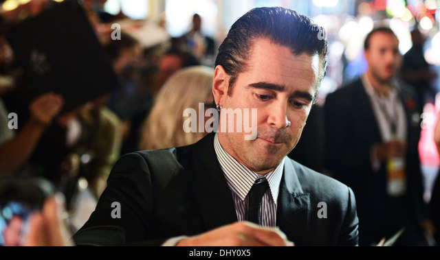 LOS ANGELES - NOVEMBER 8: The actor Colin Farrell signs an autograph for a fan November 8, 2013 in Los Angeles, - Stock Image