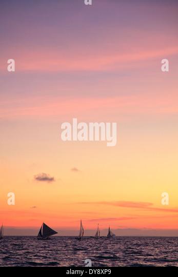 Philippines, Visayas, Boracay Island, White Beach, traditional sail boats at sunset - Stock-Bilder