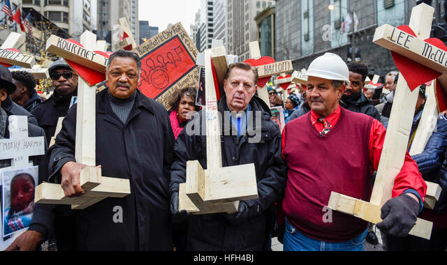 Chicago, USA.  31 December 2016. Jesse Jackson (L) joins a Peace March, organised by Father Michael Pfleger (C) - Stock Image