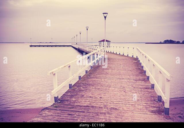 Vintage retro filtered wooden pier at sunset. - Stock-Bilder