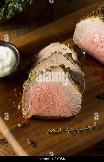 Homemade Herb Crusted Roast Beef with Horseradish Sauce - Stock Image