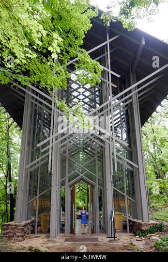 Arkansas Eureka Springs Thorncrown Chapel architect E. Fay Jones design glass steel woman door woodland setting - Stock Image