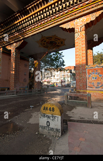 Mile stone Zero of the Thimphu Highhway at the Gate of Bhutan in Phuentsholing, Bhutan - Stock Image