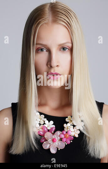 Ornamentation. Snazzy Blond Woman with Floral Necklace - Stock Image