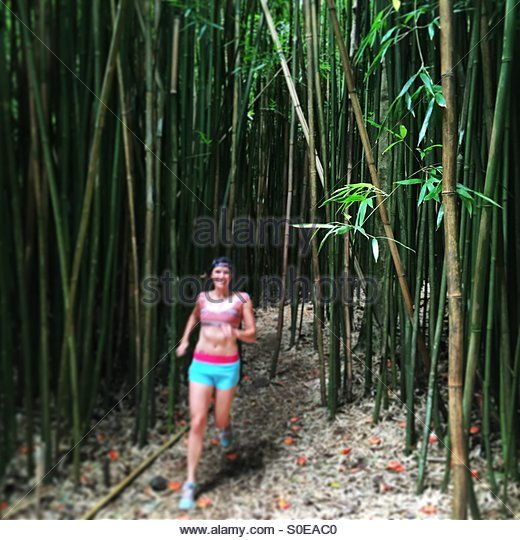 Running through the bamboo forest - Stock-Bilder