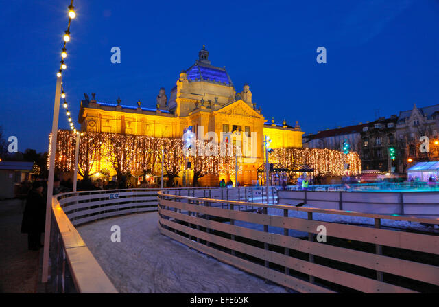 Zagreb pavilion by night with skating ring in Christmas time in front - Stock Image