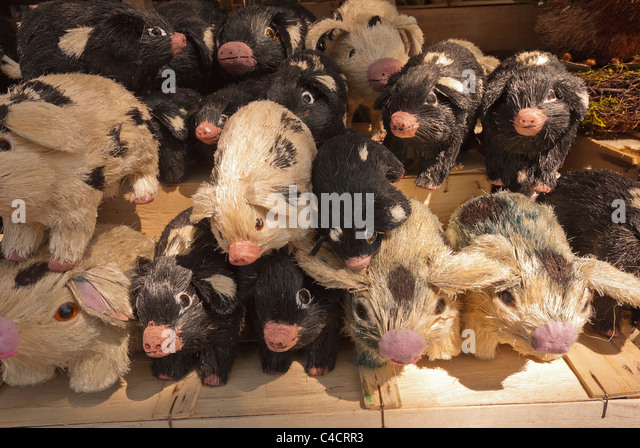 Stuffed animals, piglets, for sale in the local outdoor market, known as Viktualienmark, in Munich, Germany. - Stock Image