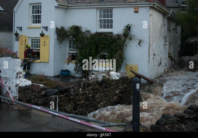 Coverack, Cornwall. 18th July 2017.   River next to local house rages during flash flood in coastal village of Coverack, - Stock Image