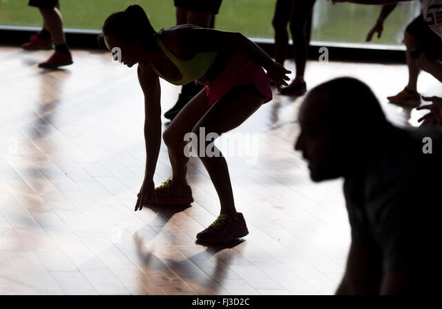 group exercise session in a gym - Stock-Bilder