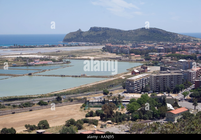 Cagliari Salt Flats and the  Devil s Saddle Sardinia   flat salt pan shallow lagoon Devil s Saddle Sella del Diavolo - Stock Image