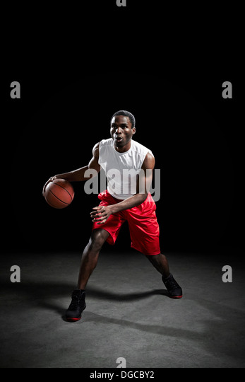Basketball player preparing to shoot ball - Stock Image