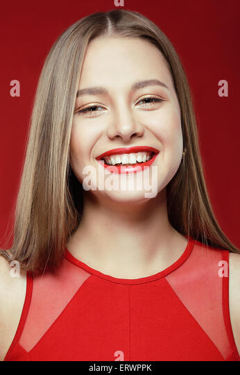 Lucky Happy Woman with Toothy Smile - Stock Image
