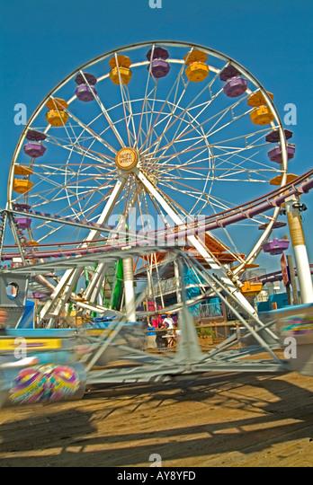 Santa Monica Pier California, CA, USA, US sandy beach, blue water, waves, people  hotels, ferris wheel, ocean park - Stock Image