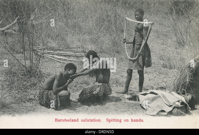 Zambia - Spitting on Hands Greeting - Stock Image