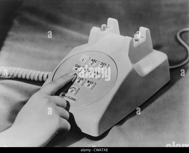 Bell Telephone Company introduced the push-button telephone in 1959 to replace the rotary dial phones. The phone - Stock Image