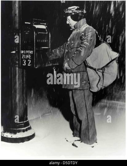 Letter Carrier in Snow - Stock Image