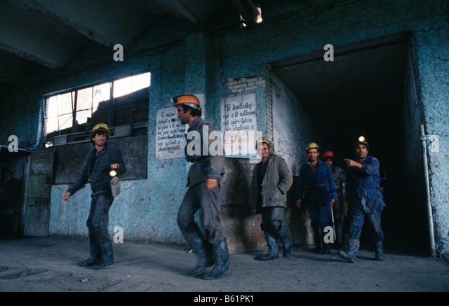 Coal miners at entrance to mine shaft, Albania 1992 - Stock Image