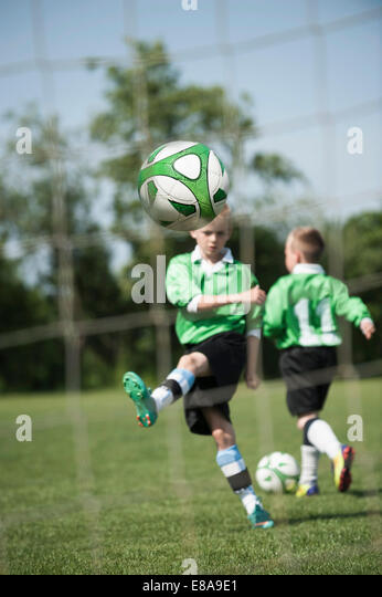 Young junior soccer kids practicing penalty - Stock Image