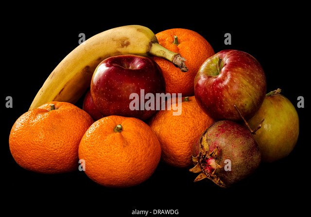 Mound of Fresh Fruit. Apples, Oranges, Banana, Pomegranate on a black background. - Stock Image