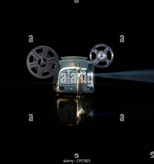 Glowing movie projector with reel - Stock-Bilder