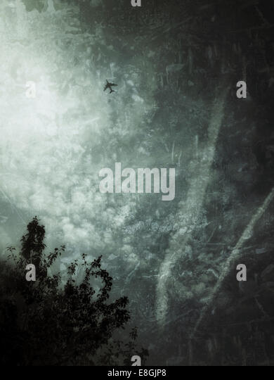 UK, London, Airplane flying through moody skies - Stock Image