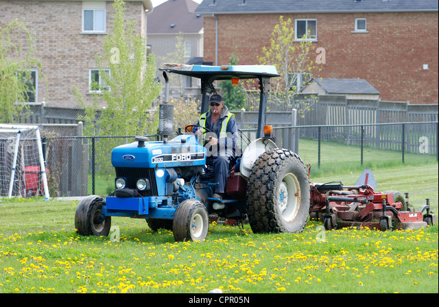 Man On Tractor Lawn Enforcment : Lawn tractor stock photos images alamy