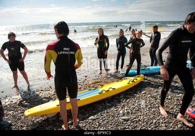 RNLI lifeguard training session, Aberystwyth beach, Wales UK - Stock Image
