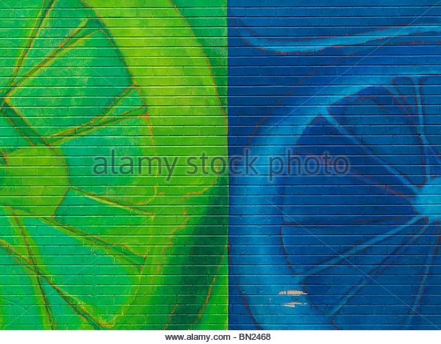 Abstract colorful green blue mural graffiti on a brick wall - Stock-Bilder