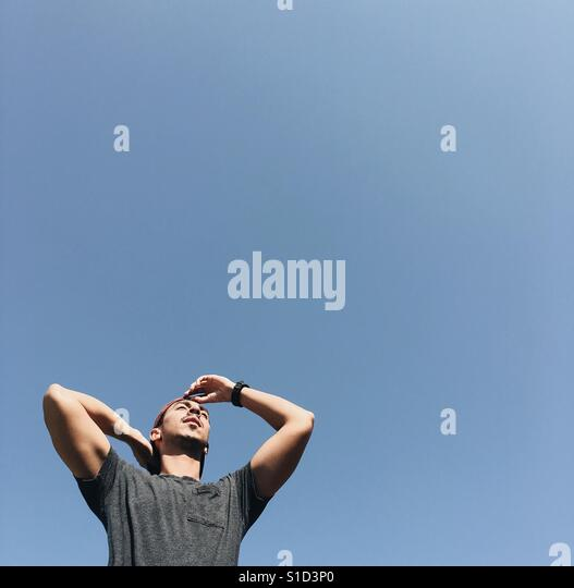 Standing in the sun - inspirational, looking to the future - Stock-Bilder