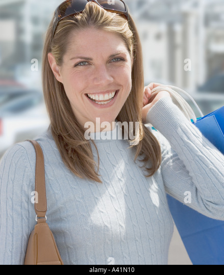 Portrait of a woman shopping - Stock Image