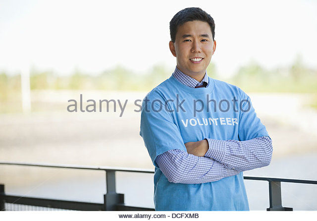 Portrait of confident volunteer - Stock Image