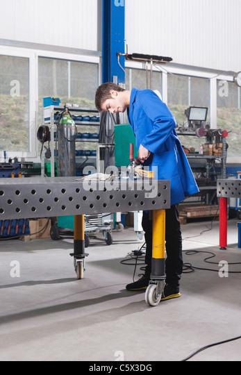 Germany, Neukirch, Apprentice working on work bench - Stock-Bilder