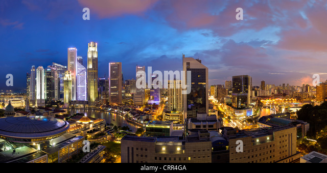 Skyline and Financial district at dusk, Singapore, Southeast Asia, Asia - Stock Image